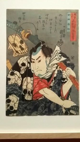 Estampe de Kuniyoshi représentant Gosuke qui travaillant dans un magasin funéraire