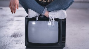 girl sit on tv