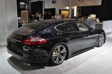2011 black Porsche Panamera Turbo S at New York Autoshow Rear angle side view
