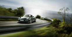2011 Porsche Racing Green Metallic Boxster Front angle view