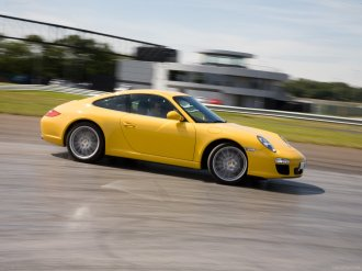 2009 Yellow Porsche 911 Carrera Wallpaper Side view