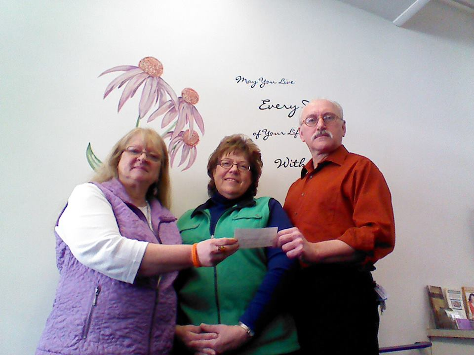 Rita Briant owner of Prairie Flower Beads Portage, June Paul and Dale Paul
