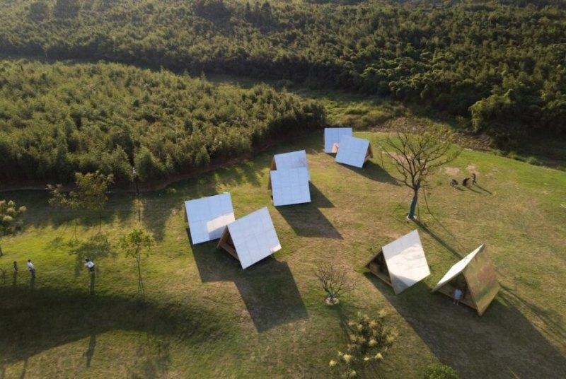 , Familias en China crean una eco-comunidad de cabañas de madera
