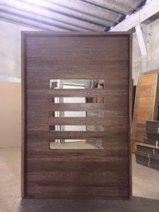 Porta pivotante de madeira - entrada - Luxo