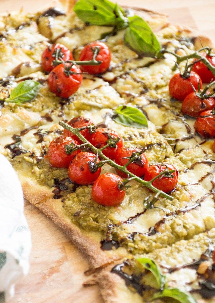 Blistered Caprese Pizza with Garlic Scape Pesto