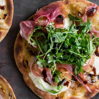 Caramelized Onion, Prosciutto & Arugula Pizza