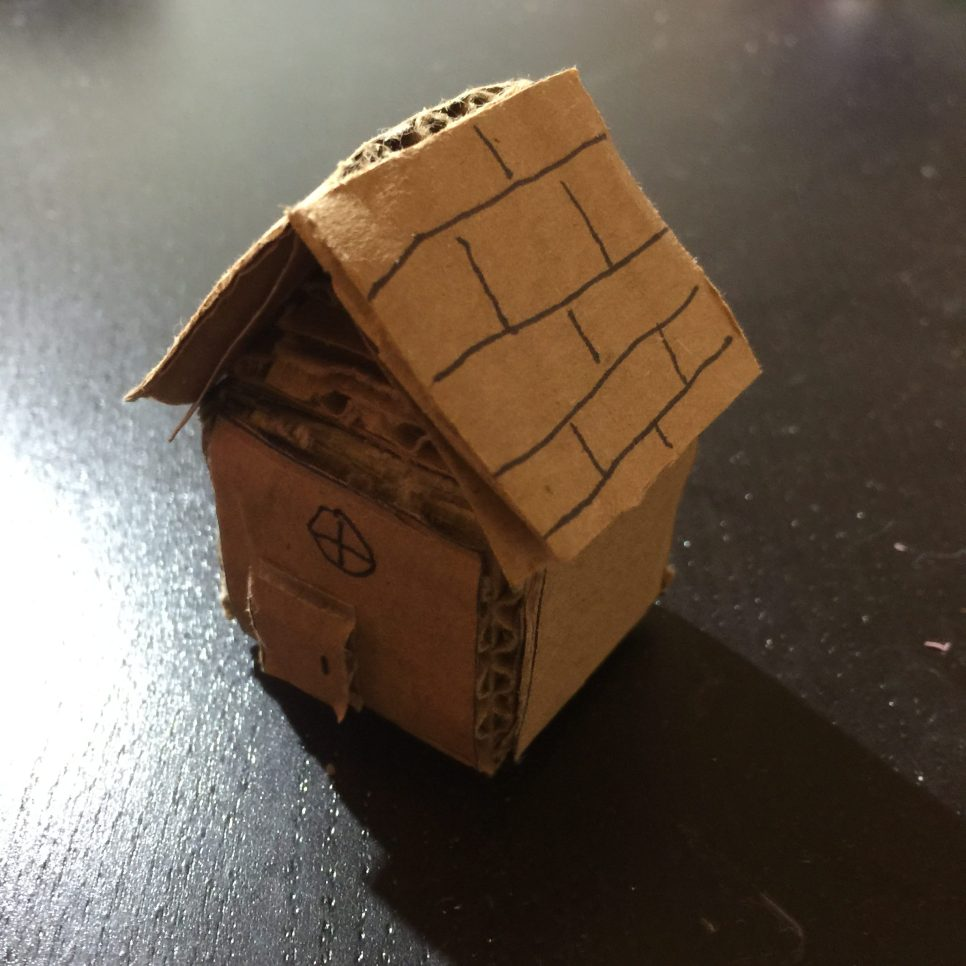 Emily liked to play toys when she was young so I build a cardboard house for her