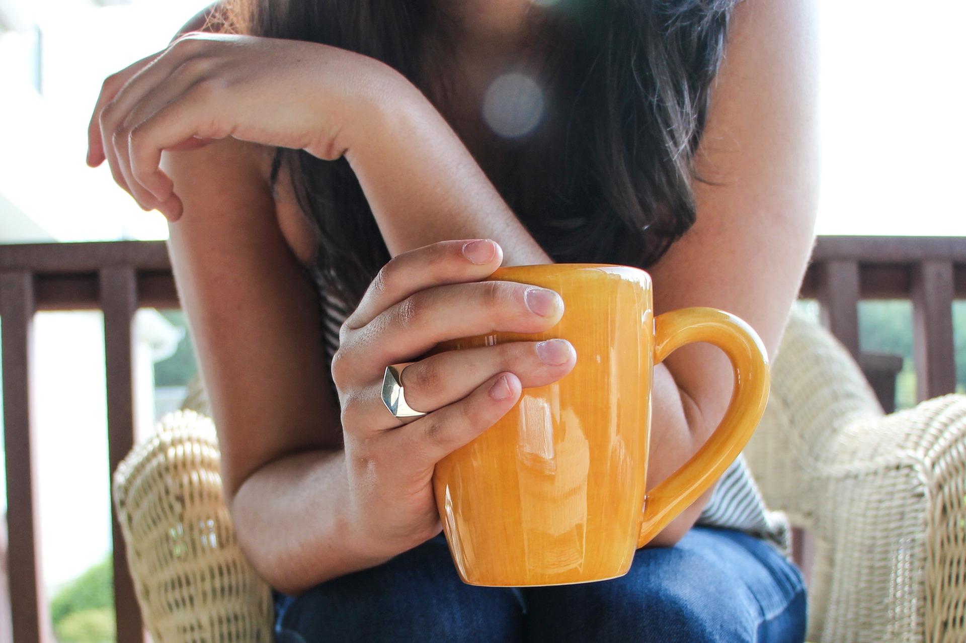 Happy Investors Enjoy Portfolio Charts With Coffee