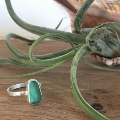 A bright turquoise sea glass ring.