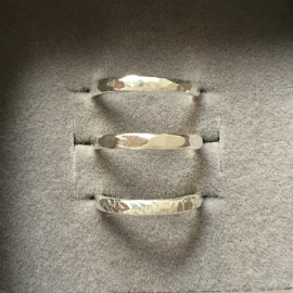 3 rings in a row showing three different finished to seaglass rings: round hammered; flat regular hammered and sharp hammered