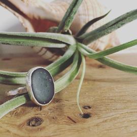Black sea-pebble ring Swanpool.