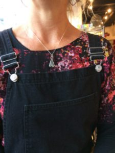 Customer wearing Porth Seaglass necklace. White mermaids-tail shaped glass.