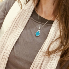 Electric blue seaglass necklace worn on its new owner!