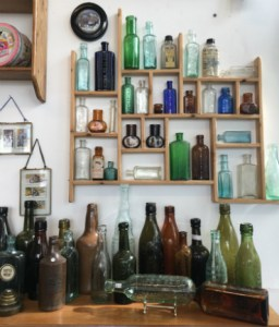 Old bottles on display at Marmalade Antiques, Falmouth.