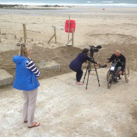 Peter Norfolk testing wheelchair ramp