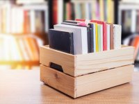 used book sale Books in wooden crate on bookshelves background