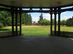 View from the bandstand to to community center. Plenty of room to spread a blanket and enjoy a picnic while listening to a concert.