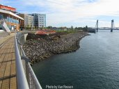 Looking from the end of the viewing platform to the Vancouver Waterfront Park and the bank of the Columbia River.