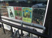 The window had handbill showing the musicians who were coming.