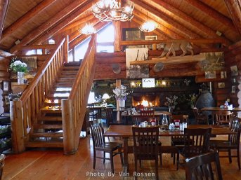 A view from the main floor look to the loft and fire place.