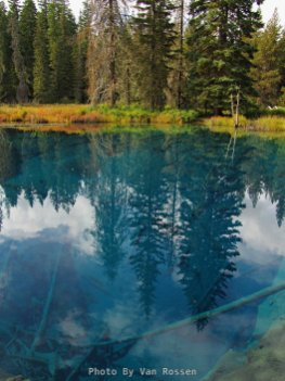 The clarity and depth of the lake give it its beautiful blue color.