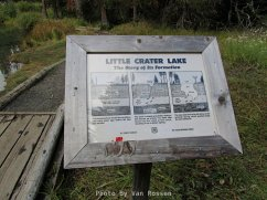 This little sign tells how Little Crater Lake was formed.