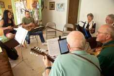 TIMES PHOTO: JAIME VALDEZ - Josh Waldman and his wife, Lyly, left, play their ukuleles with a group that they host weekly at their home in Tigard.