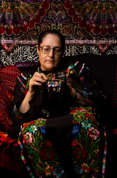SUBMITTED PHOTO - Milwaukie resident Feryal Abbasi-Ghnaim, shown here embroidering, will co-present with her daughter, Wafa Ghnaim, on Sept. 17, 18 and 19.