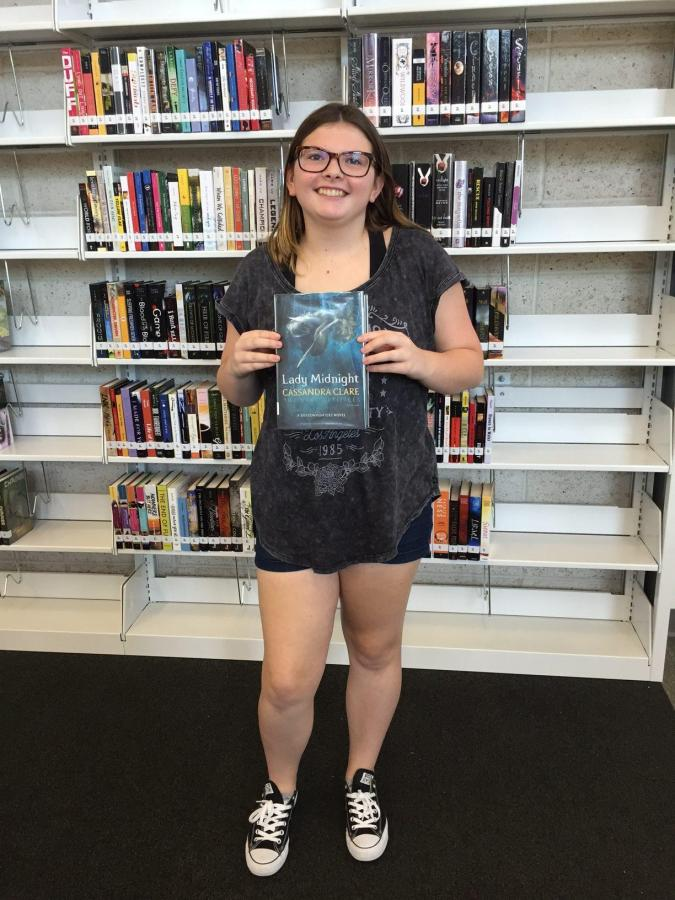 Freshman Piper Porter checked out the first book from the Learning Commons.