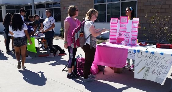 Samira Feili, pink ribbon club president, explains to students through an interactive activity the club's mission to fight breast cancer.