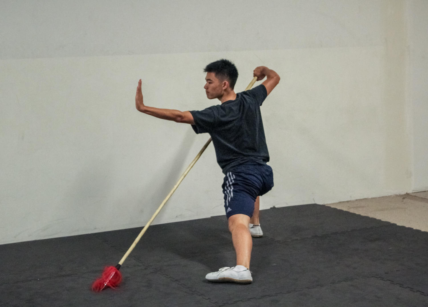 Ethan Niu trains with a spear during his routine for wushu competitions.