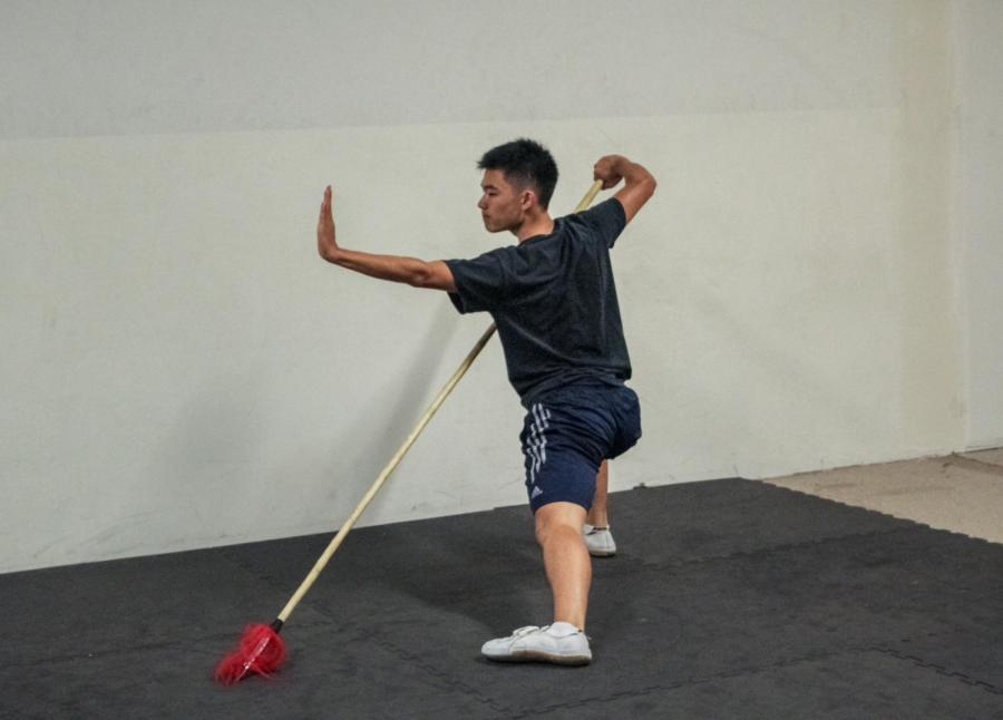 Ethan+Niu+trains+with+a+spear+during+his+routine+for+wushu+competitions.+