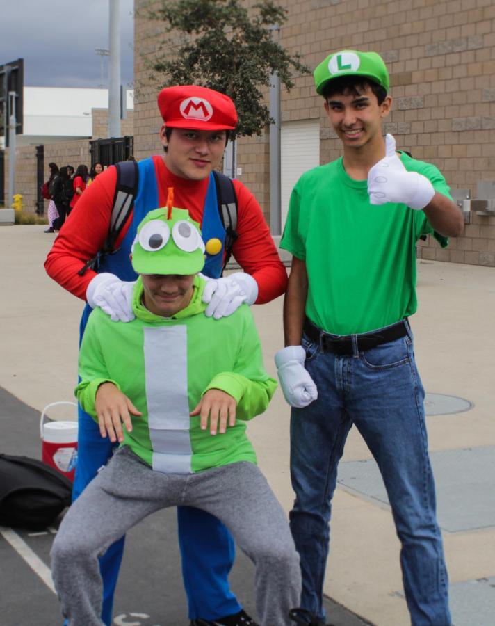 +Peyton+Dalmacio%2C+Ethann+Lopez+and+Kai+Horn+dress+up+as+the+jumping+Mario+brothers+and+the+dinosaur+Yoshi.+