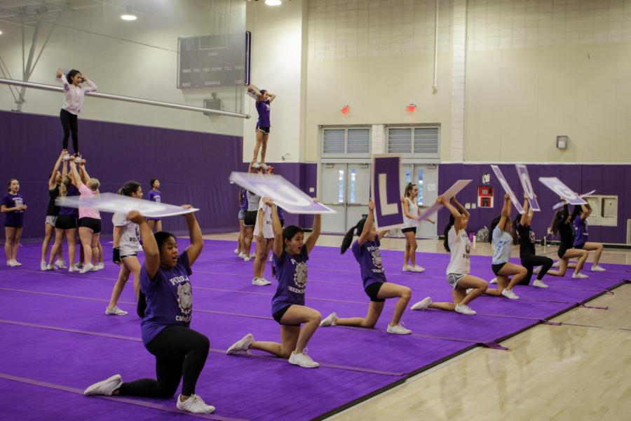 Cheer squad practices a new routine for its upcoming performances.