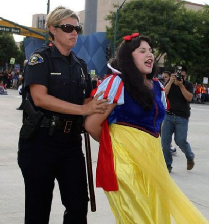 Office Jennifer Johsen arrests a Disneyland actress dressed up like Snow White who was protesting at a labor rally.