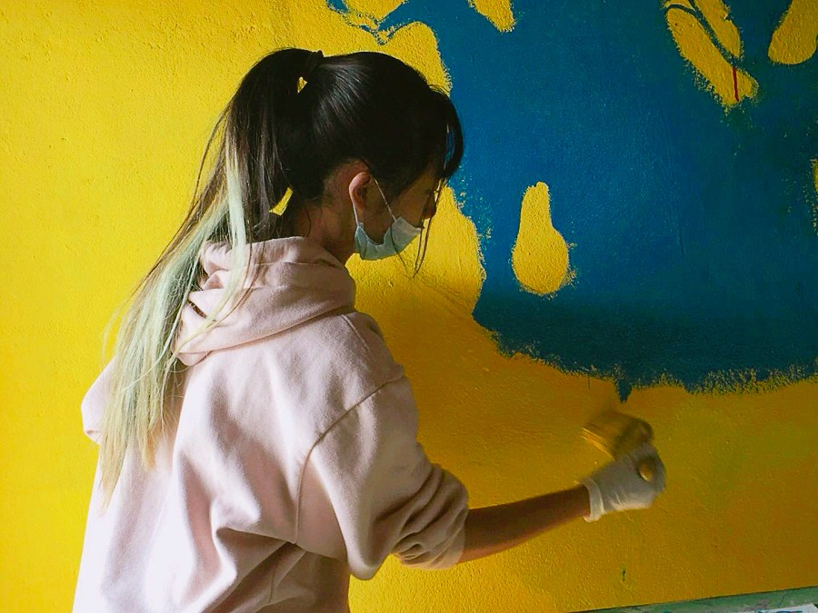 Paris+Zhuang+painted+a+beautiful+mural+of+the+earth+on+the+walls+of+the+local+secondary+school+in+Nepal.