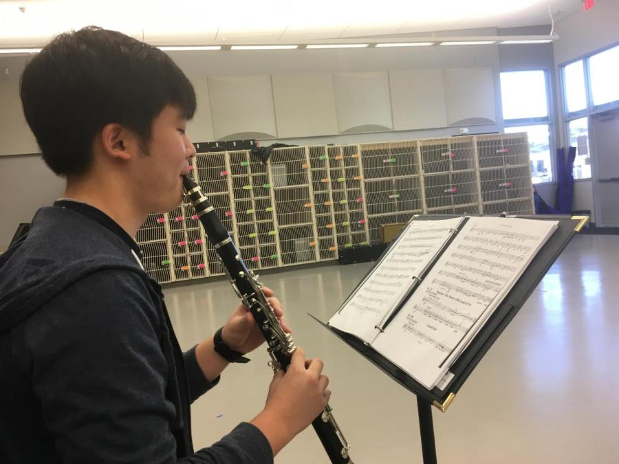 Sophomore+Brett+Shin+takes+time+outside+of+class+to+practice+his+pit+orchestra+music+in+order+to+be+prepared+for+the+rehearsals.+