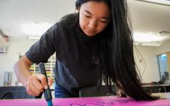 As the publicity commissioner, sophomore and ASB member Allison Shi works on one of many posters advertising the spring carnival that will be displayed around campus.