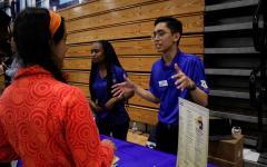 Sophomore Samira Feili speaks with a University of California, Irvine student regarding science majors offered at the institution.