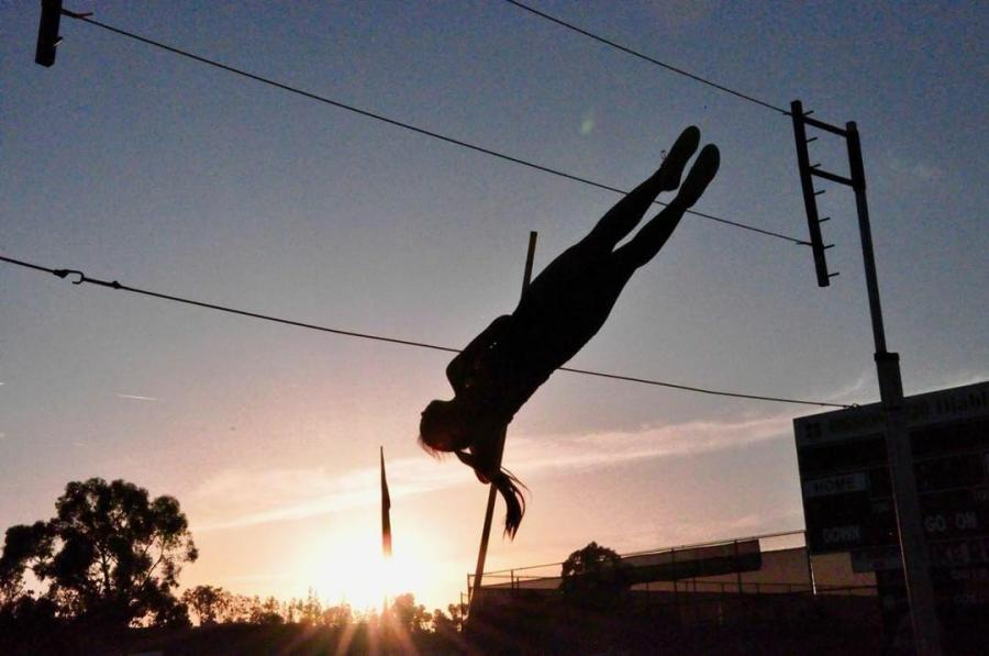 Ng%27s+dedication+towards+pole+vaulting+has+lead+her+to+practice+out+of+school+at+Mission+Viejo+to+supplement+her+normal+track+practice.