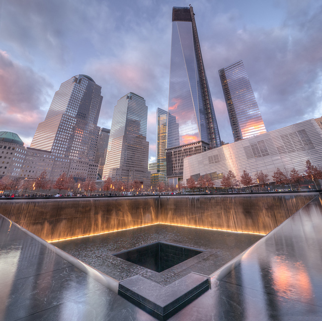 The 9/11 Memorial at New York City commemorates the names of nearly 3,000 people who died in the attacks, including civilians and first responders.