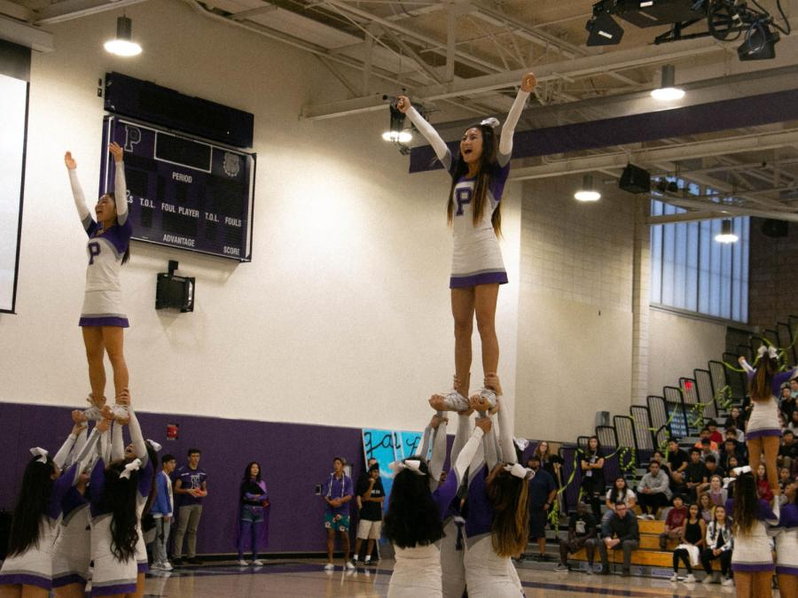 Junior+Jessalyn+Nguyen+chants+%E2%80%9Cvictory%21%E2%80%9D+while+in+her+stunt.+Nguyen+is+one+of+the+team%E2%80%99s+many+fliers%2C+and+has+been+a+flier+for+three+years