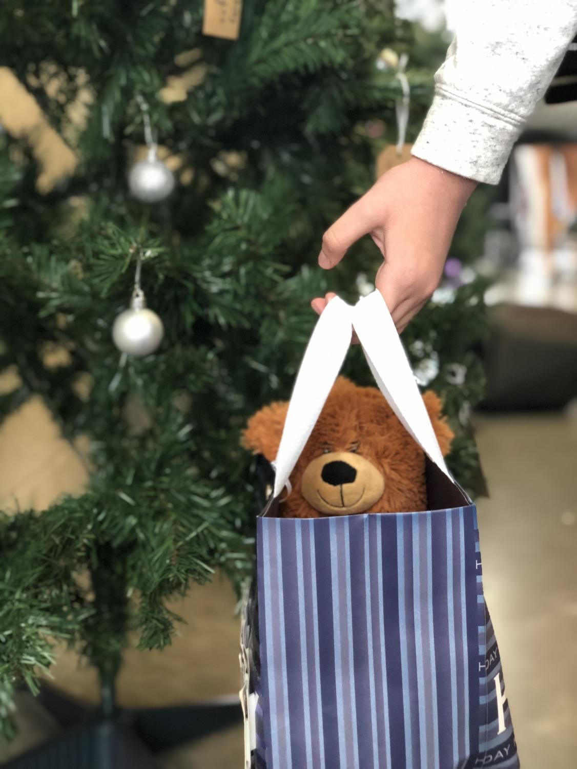 Students can donate to Toys for Tots by bringing in new toys and placing them under one of the three Christmas trees in the Student Union.