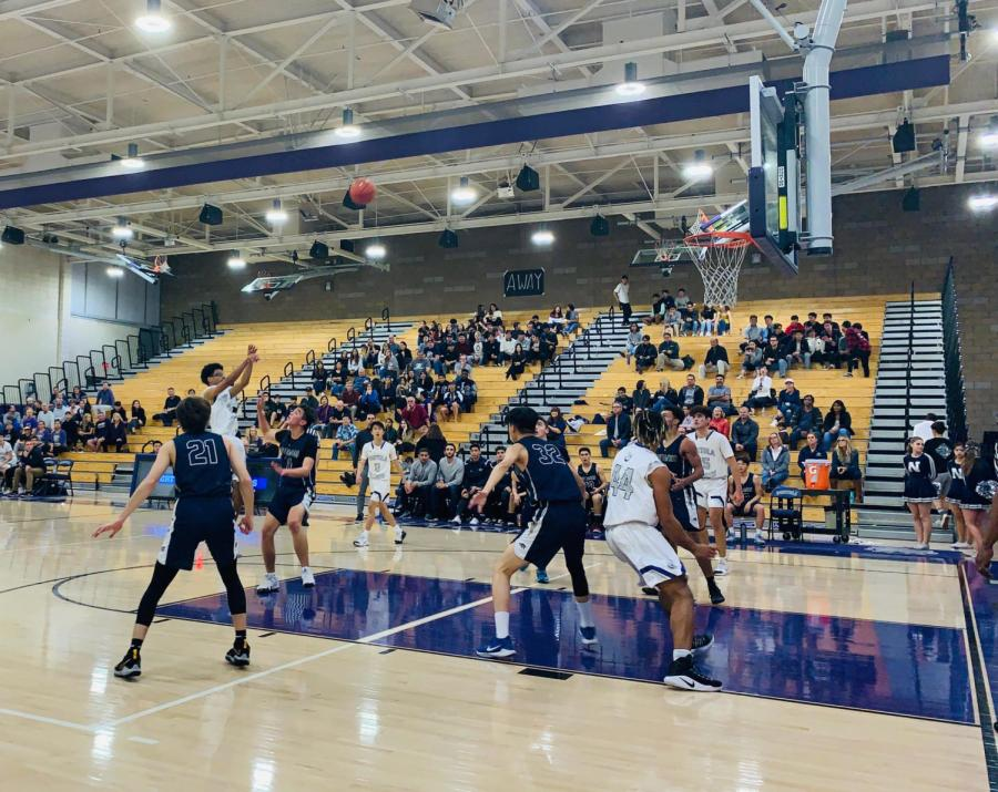Junior and starting small forward Soma Doherty breaks through Northwood High's defense to shoot for a two-pointer at the Game of the Week.