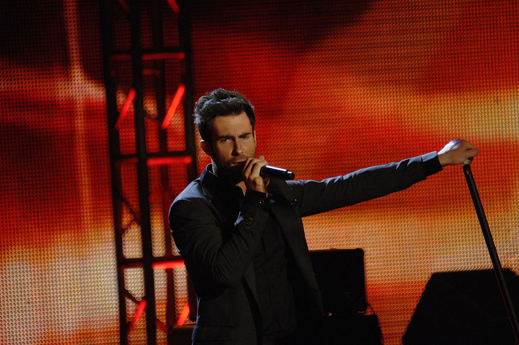 During the Super Bowl halftime show, Adam Levine performed live with his band Maroon 5 to over 70,000 people, with an additional 100 million watching at home.
