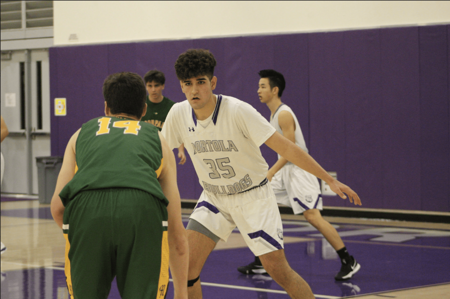 Power forward and junior Mohsen Hashemi plays man-to-man defense and guards against Moorpark High's forward at the second round of CIF on Feb. 12. Throughout the season, the team continued to improve on their defensive playing, although they faced difficulty against strong players from Moorpark High.