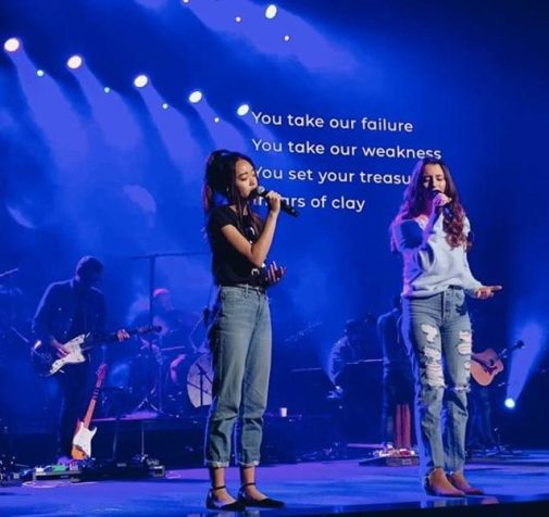 Sophomore Kailyn Pham (left) sings powerfully during one of the Mariner Youth Culture Band's performances. Pham has been working effortlessly in order to use her music prowess to help better impact her surrounding community.