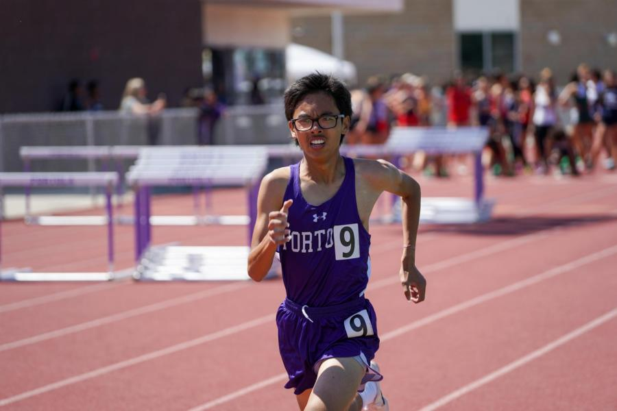 Junior Thomas Chen accelerates during his desperate sprint to the finish line during his 1600 race. Chen came in 12th in the JV category, securing the last spot in the PCL Finals.