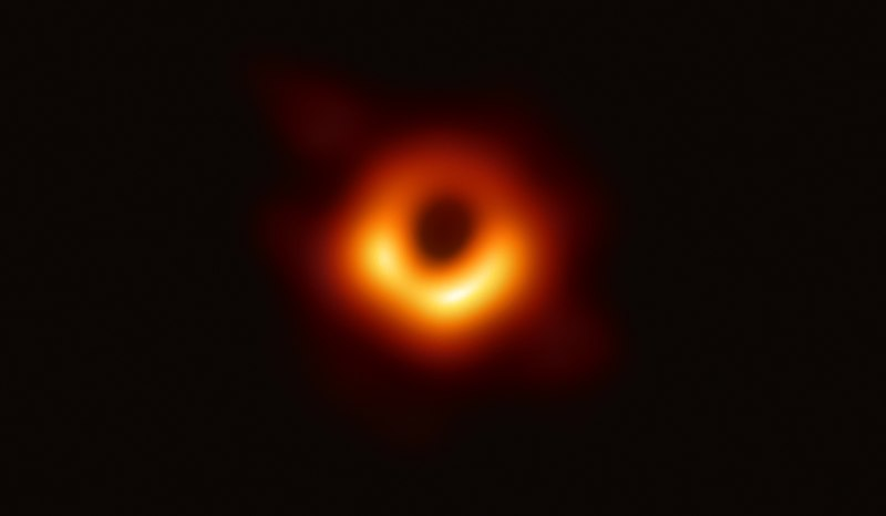 Produced by the Event Horizon Telescope on April 10, a golden ring where the event horizon is surrounds the silhouette of a black hole in the center.