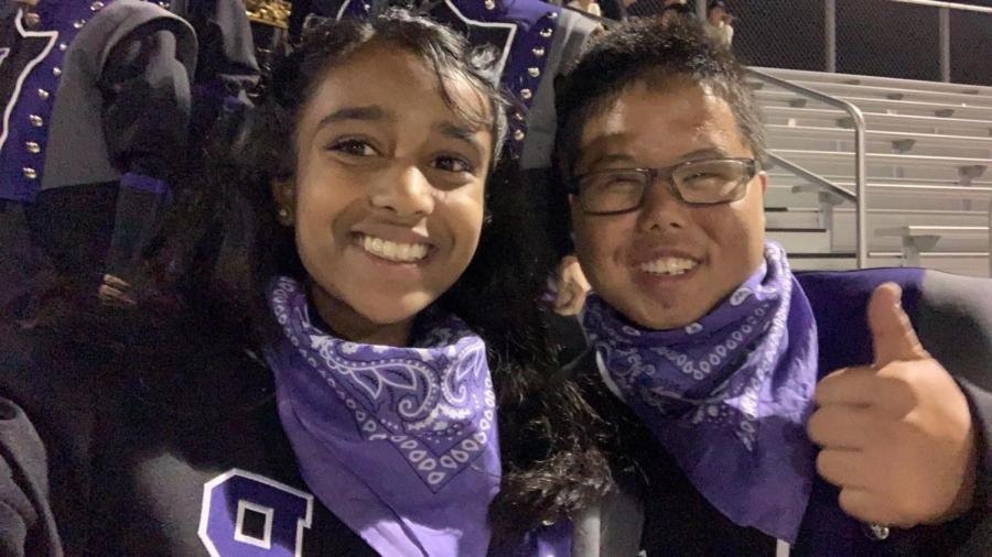 Sophomores Pranathi Kollolli and Joshua Ong celebrate at one of the football games this year. The pair were members of the marching band pit section this year and spent time working together, playing cymbals, and enjoying the experience
